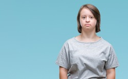 Young adult woman with down syndrome over isolated background with serious expression on face. Simple and natural looking at the camera.