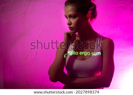 Young adult woman with words o Rene Descartes Cogito Ergo Sum translated from Latin language as I Think Therefore I am on her body. Foto stock ©