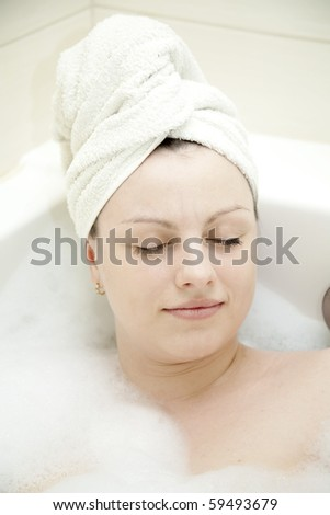 stock photo : young adult women having spa in bathroom and relax