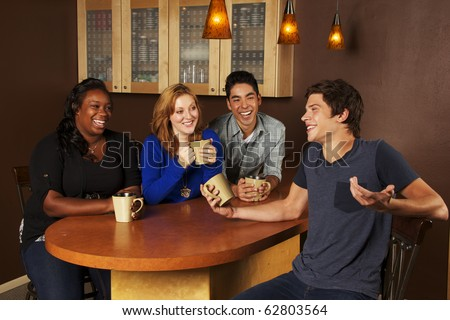 Young Adults hanging out in coffee house