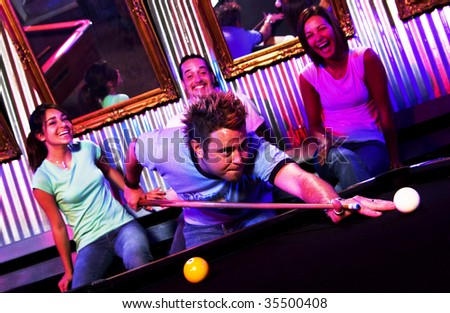 young adults playing pool at nightclub