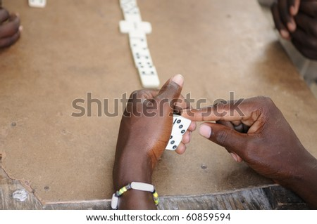 Young adults playing the game of Domino.