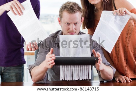 young adults studying together in a library - stock photo