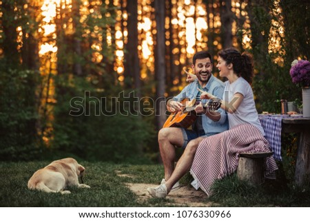 Young affectionate couple enjoying outdoors #1076330966
