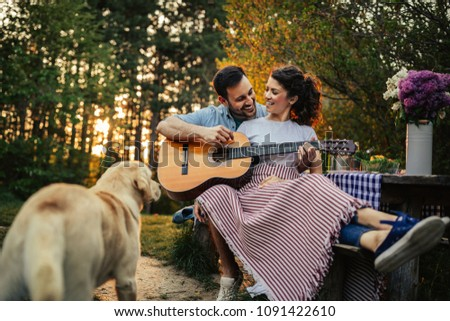Young affectionate couple enjoying outdoors #1091422610