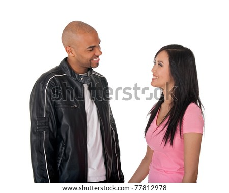 Young affectionate couple hugging - African American guy with Asian girlfriend.