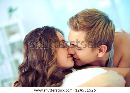 Young affectionate couple kissing