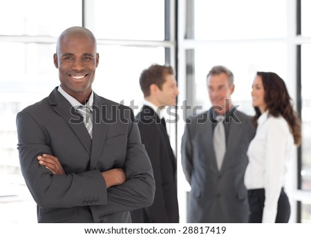 Young african-america Businessman in Front of Team