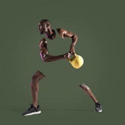 Young african-american bodybuilder training on green studio background. Muscular male model with the weight. Concept of sport, bodybuilding, healthy lifestyle, movement, action. Abstract design.