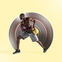 Young african-american bodybuilder training on yellow studio background. Muscular male model with the weight. Concept of sport, bodybuilding, healthy lifestyle, movement, action. Abstract design.