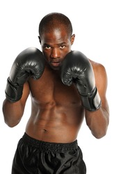 Young African American Boxer wearing punching gloves isolated on a white background