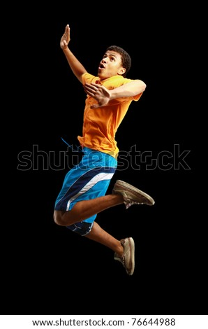 Young african American boy jumping with extended arms
