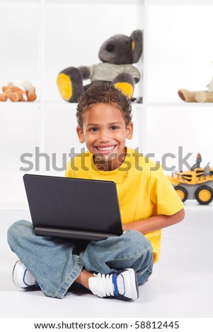 young african american boy playing on laptop computer