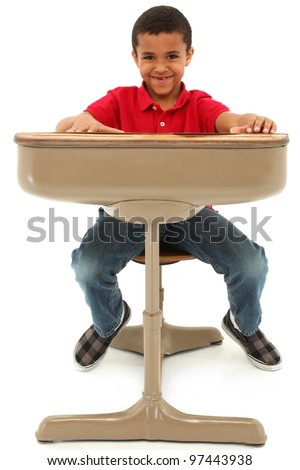 Young African American Boy Sitting In A Desk