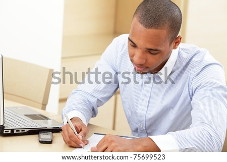 Young african american business man filling in a document