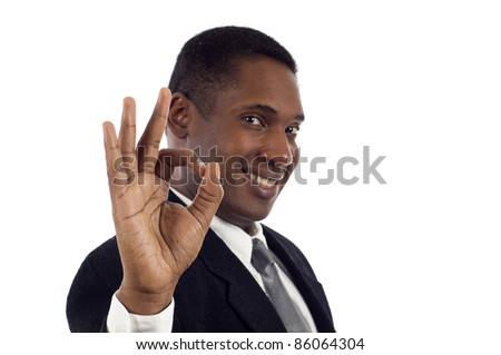 Young African American business man showing the okay sign over white background