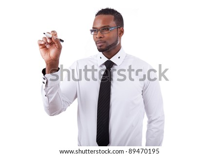 Young African american business man  writing something on glass board with a marker