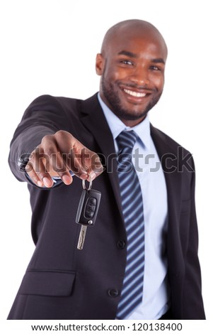 Young African American businessman holding a car key,isolated on white background