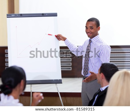 Young african-american businessman making a presentation