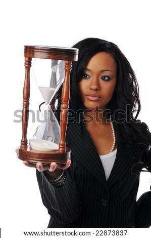 Young African American businesswoman holding a sand clock isolated on white