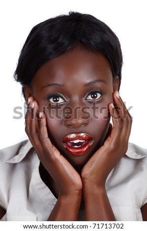 young African American businesswoman holding her face in the hands with open mouth in surprise, isolated on white