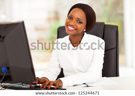 young african american businesswoman working on computer