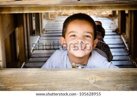 Young african-american child eating healthy snack while playing on playground