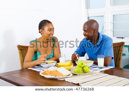 young african american couple having healthy breakfast together
