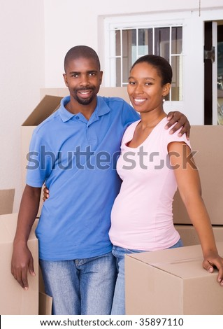 young african american couple moving house