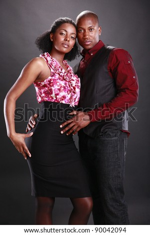 Young african american couple on black