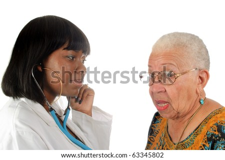 young african american doctor checking elderly patients heartbeat, isolated on white background - stock photo