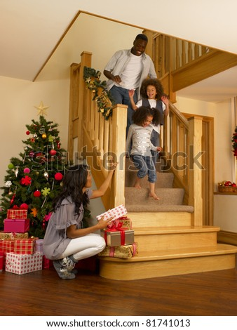 Young African American family on Christmas morning