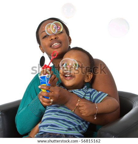 Young african american family playing around with bubbles. Fresh young image.