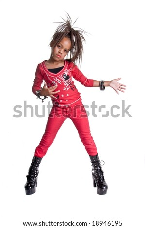 Young African American girl playing dress up like she is a hip hop singer