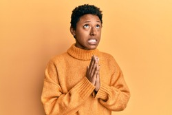 Young african american girl wearing casual clothes begging and praying with hands together with hope expression on face very emotional and worried. begging.