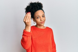 Young african american girl wearing casual clothes doing italian gesture with hand and fingers confident expression