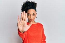 Young african american girl wearing casual clothes doing stop sing with palm of the hand. warning expression with negative and serious gesture on the face.