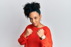 Young african american girl wearing casual clothes ready to fight with fist defense gesture, angry and upset face, afraid of problem