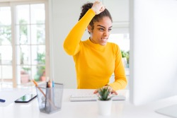 Young african american girl working using computer annoyed and frustrated shouting with anger, crazy and yelling with raised hand, anger concept