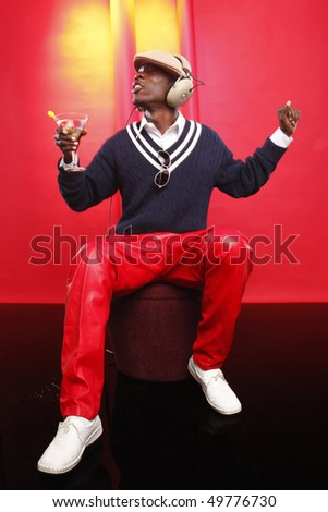 Young african american having a cocktail at the lounge