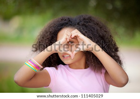 young african american kid making heart shape with hands