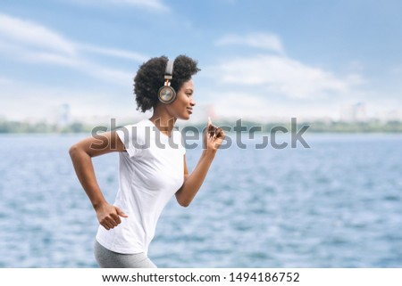 Young African American Lady Jogging Near River. Morning Workout And Running. Copy Space