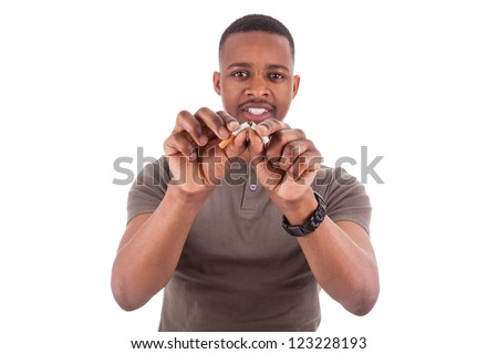 Young african american man breaking a cigarette, isolated on white background - stock photo