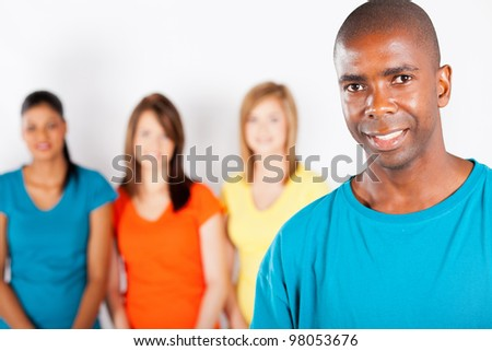 young african american man standing in front of group of girls