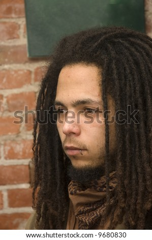 stock-photo-young-african-american-man-with-dreadlocks-lip-and-nose