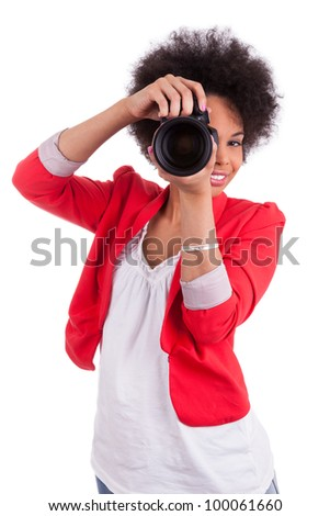 Young african american  photographer with camera, isolated on white background