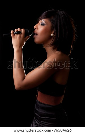 Young african american singer performing at concert