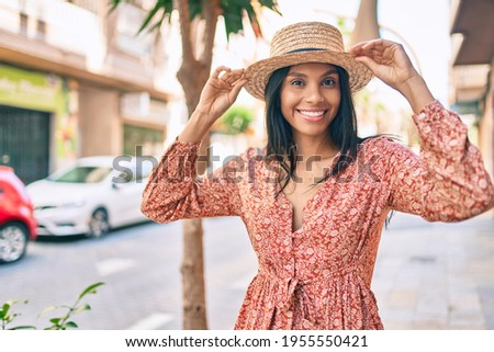 Young african american tourist woman on vacation smiling happy walking at the city.