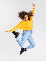 Young African American woman dancing over isolated white background