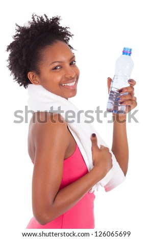 Young african american woman holding a bottle of water  over white background